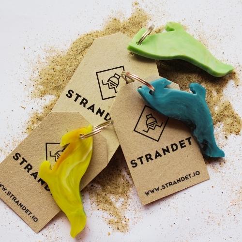 Tre sæl nøgleringe i sand
